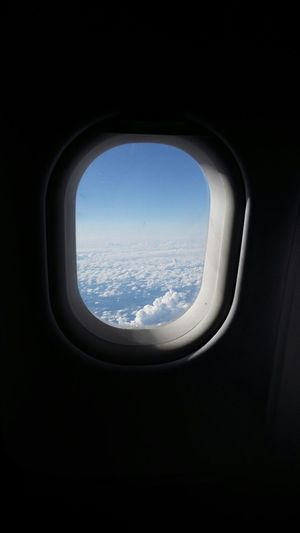 AirPlane ✈ Looking Out Of The Window Clouds And Sky Fromm Above