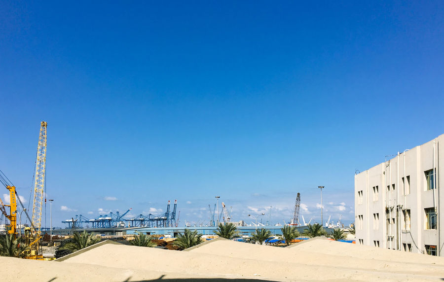 Architecture Building Exterior Built Structure City Clear Sky Container Crane Container Cranes Container Terminal Crane Cranes Dami Egypt No People Outdoors Port Sky Travel Destinations
