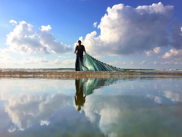 Reflection of a young woman on water