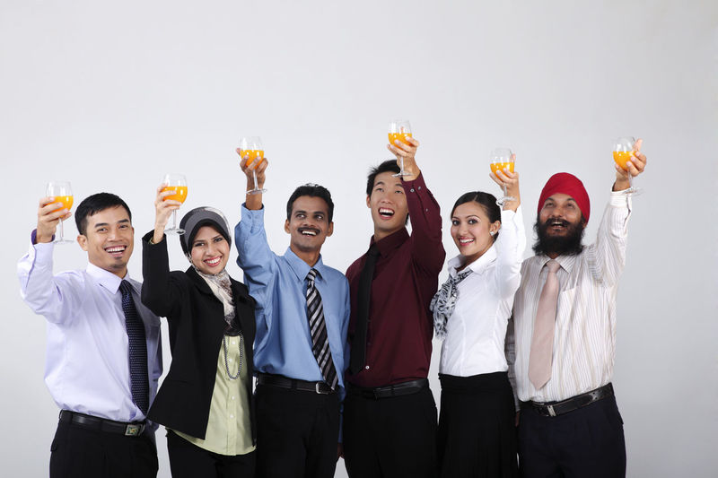 group of people holding glass of orange juice Business Celebration Happiness Indian Teamwork Toast Business Person Chinese Formal Dress  Friendship Front View Group Of People Harmony Malay Malaysian Mixed Race Multi Racial Orange Juice In Glass Portrait Punjabi Studio Shot Turban United Waist Up Women