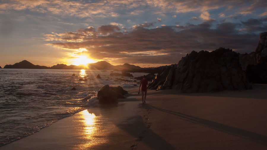 Adult Adults Only After The Swim Alone Beach Beauty In Nature Cabo San Lucas Cloud - Sky Day Dramatic Sky Nature Outdoors Peaceful People Sand Sky Sun Sunset Tranquility