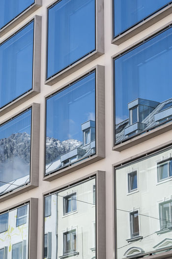 Architecture Architecture_collection Austria City City Street Cityscapes Coexistence Of Contrast, Opposition, Opposite, Antithesis, Conflict, Contradistinction Difference, Distinction, Differential, Variation, Variance Distance, Spacing, Gap, Interval, Difference Glass - Material Juxtaposition Mirror Image, Reflection, Reflexion Modern Modern Architecture Parallel Worlds Reflection, Mirage, Reflexion Reflection, Reflexion, Reunion, Meeting Structure Structures & Lines The Architect - 2016 EyeEm Awards Urban Urban Geometry Visual Appearance Innsbruck