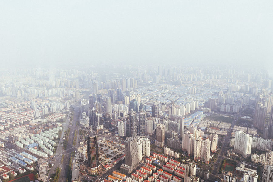 Views from the top floor of the IFC Building, Shanghai China. Aerial View Architecture Building Exterior Built Structure China City Cityscape Clear Sky Community Composition Copy Space Crowded Culture Day Development Elevated View Famous Place High Angle View Human Settlement Outdoors Perspective Residential District Shanghai Top Perspective Travel Destinations