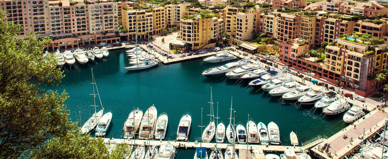 Marina Apartment Architecture Banner Boats Building City Cityscape Coast Coastal Day Destination District Europe Exterior Famous Fontvieille French Riviera Harbor Horizontal Houses Landmark Landscape Luxury Mediterranean  Modern Monaco Nature Outdoor Panorama Panoramic Pier Port Principality Residential  Resort Rich Sea Seafront Seaside Sightseeing South Summer Tourism Touristic Town Travel Vessel View Yacht