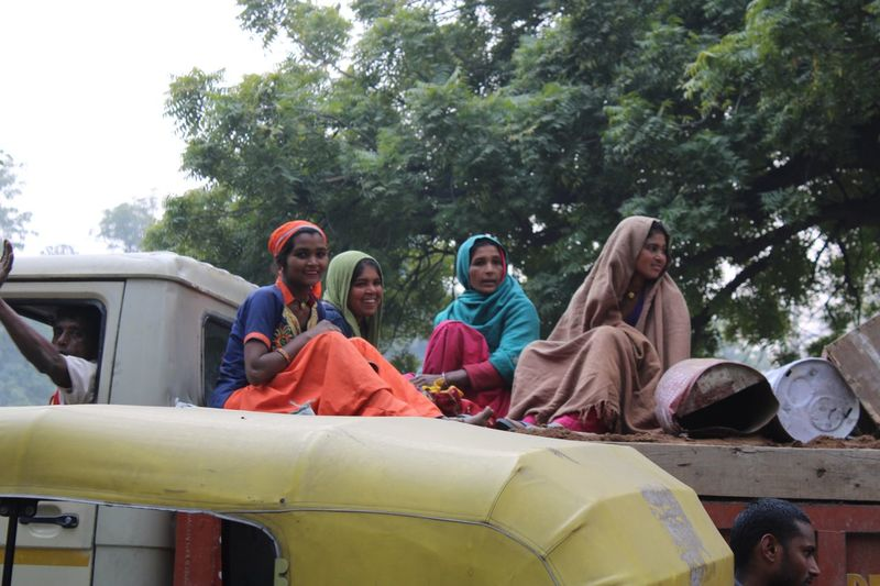 Happy workers Group Of People Mode Of Transportation Transportation Plant Day Women Real People Sitting Motor Vehicle
