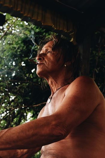 Portrait of shirtless man looking away