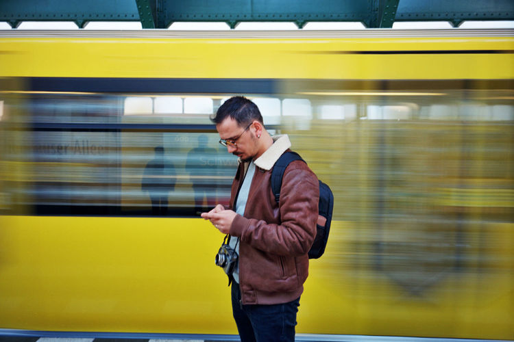 Full length of man standing on train