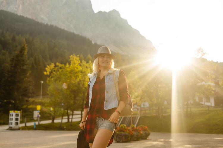 girl mountain International Women's Day 2019 One Person Sunlight Three Quarter Length Young Women Nature Lens Flare Lifestyles Leisure Activity Young Adult Standing Smiling Casual Clothing Beauty Women Front View Happiness Looking At Camera Real People Hair Beautiful Woman Hairstyle Outdoors