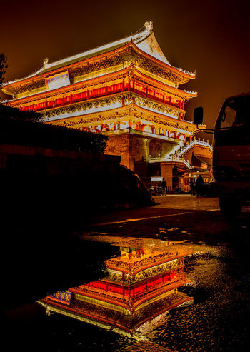 Architecture Building Exterior Built Structure City City Life Culture Drum Tower Illuminated Night Outdoors Road Sky Street Travel Destinations