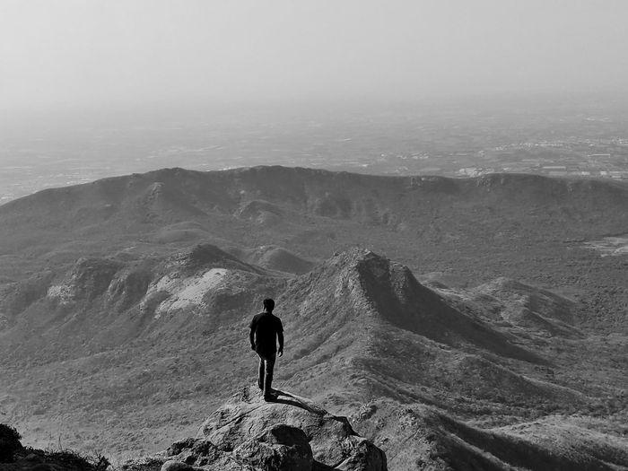 Rear view of men on mountain