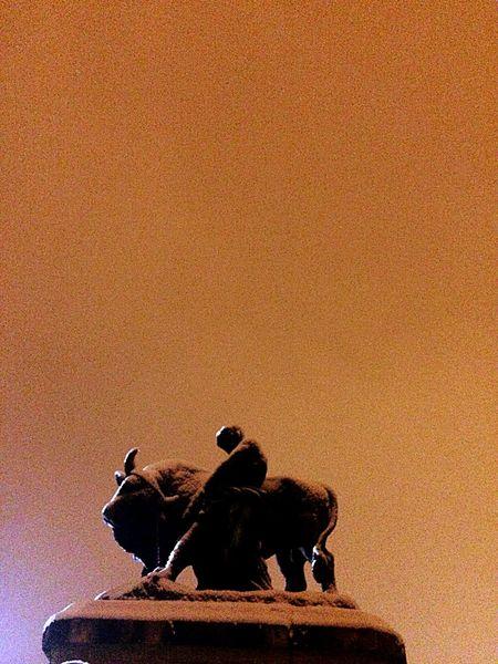 Statue Orange Sky