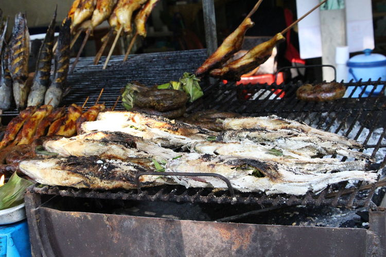 Close-up of preparing seafood on barbecue grill