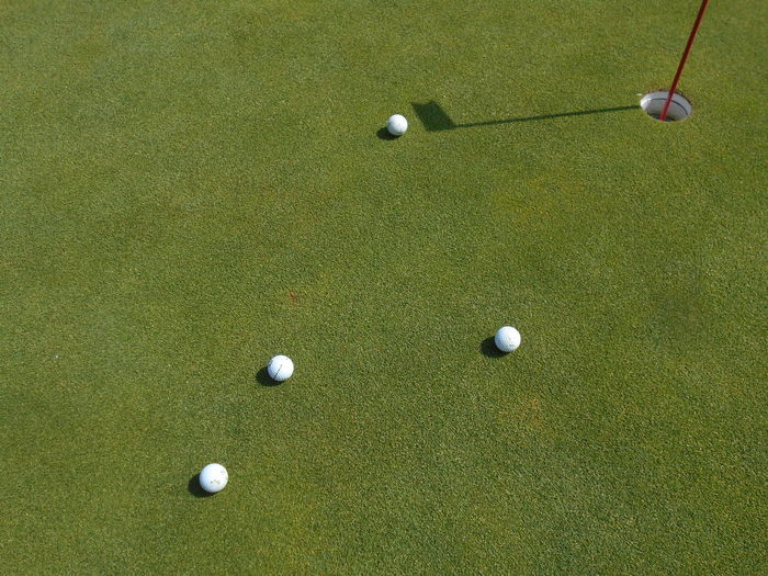 High angle view of balls on golf course