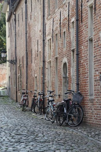 Bicycle Architecture Building Exterior Outdoors Built Structure Transportation Day Brick Wall Mode Of Transport Street City Stationary No People Belgium Leuven