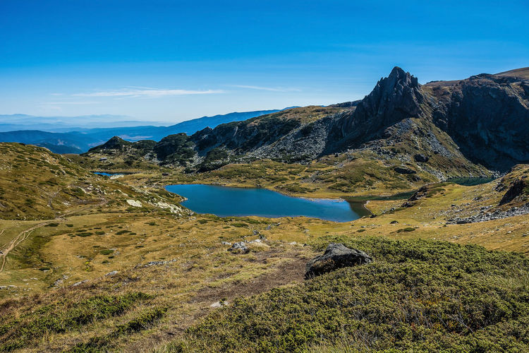 Seven Rila Lakes, Bulgaria The Trefoil Трилистника (Trilistnika) 2,216 m (7,270 ft) 2.6 ha (6.4 acres) 6.5 m (21 ft) Mountain Peak Lake View Nature Photography Nature_collection Outdoors Plant Rock - Object Solid Mountain Range Idyllic Water No People Landscape Environment Day Rock Nature Sky Non-urban Scene Tranquility Beauty In Nature Scenics - Nature Tranquil Scene Mountain Cloud - Sky