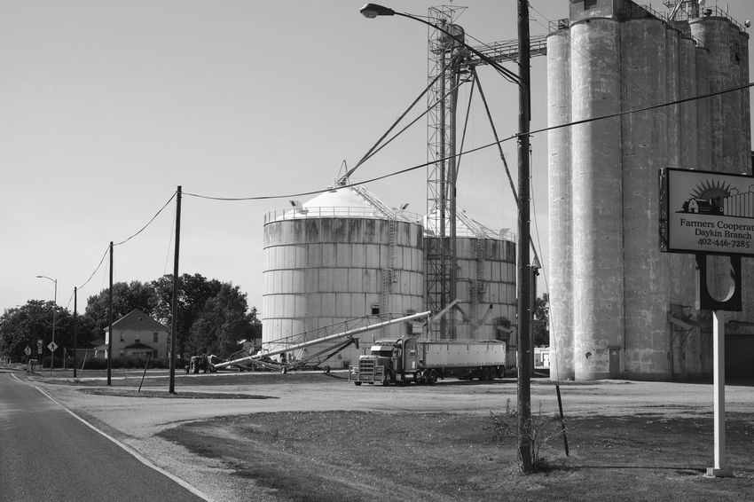 Visual Journal September 2017 Southeast Nebraska Camera Work Daykin, Nebraska Everyday Lives EyeEm Gallery FUJIFILM X-T1 Grain Silo Grain Elevator Nebraska Photo Essay Rural America Visual Journal Always Taking Photos Built Structure Bw_collection Clear Sky Day Eye For Photography Factory Farmers Life Fujinon 35mm 1.4 Industry Monochrome Monochrome _ Collection No People Outdoors Photo Diary Road Rural Life Schwarzweiß Sky Small Town Transportation