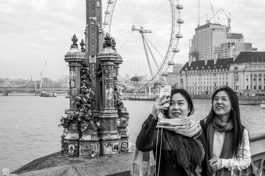 Asian girls taking a selfie in London. Holiday concept. Selfie in front of monuments and touristic attractions. young adult portrait real people Looking At Camera selfie lifestyles women building exterior London eye Travel leisure activity City water travel destinations young women outdoors tourism emotion smiling selfie in london London lifestyl Young Adult Portrait Real People Looking At Camera Selfie Lifestyles Women Building Exterior London Eye Travel Leisure Activity City Water Travel Destinations Young Women Outdoors Tourism Emotion Smiling Selfie In London 2 Girls Selfie 2 Girls