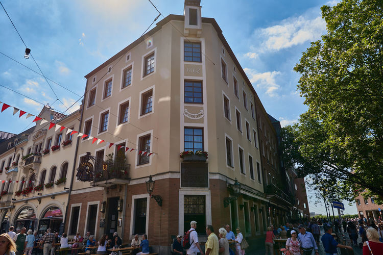 DUESSELDORF, GERMANY - AUGUST 17, 2016: The brewery pub Uerige is am attractive spot since 1682 and invites visitors for an Alt beer Alstd Colorful Diversity Düsseldorf High Resolution Lifestyle People Rheine Shopping Tourism Travel Turis Destina Walking Around Water