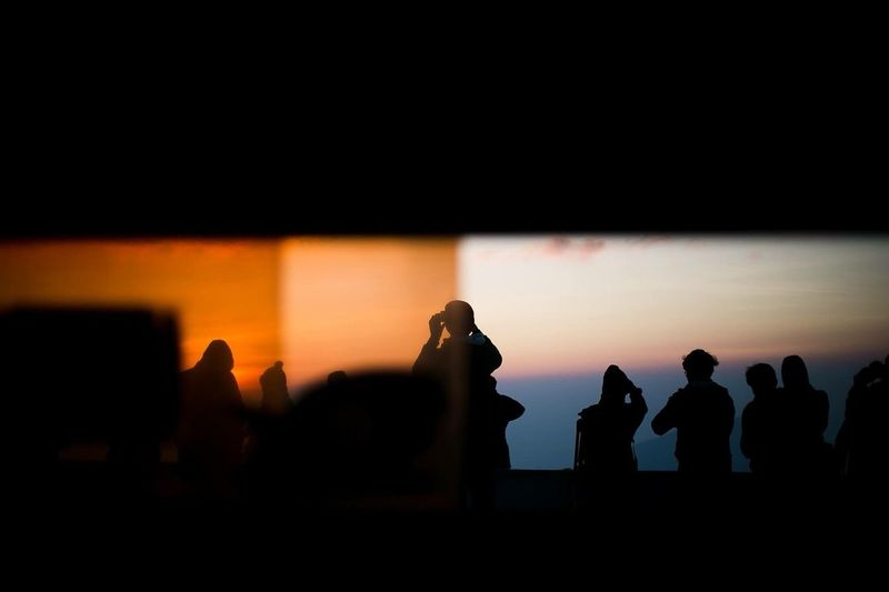 Silhouette Of People Looking At View