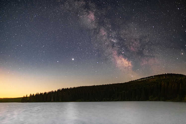 Last milky way over the volcanic lake of servière during moonrise