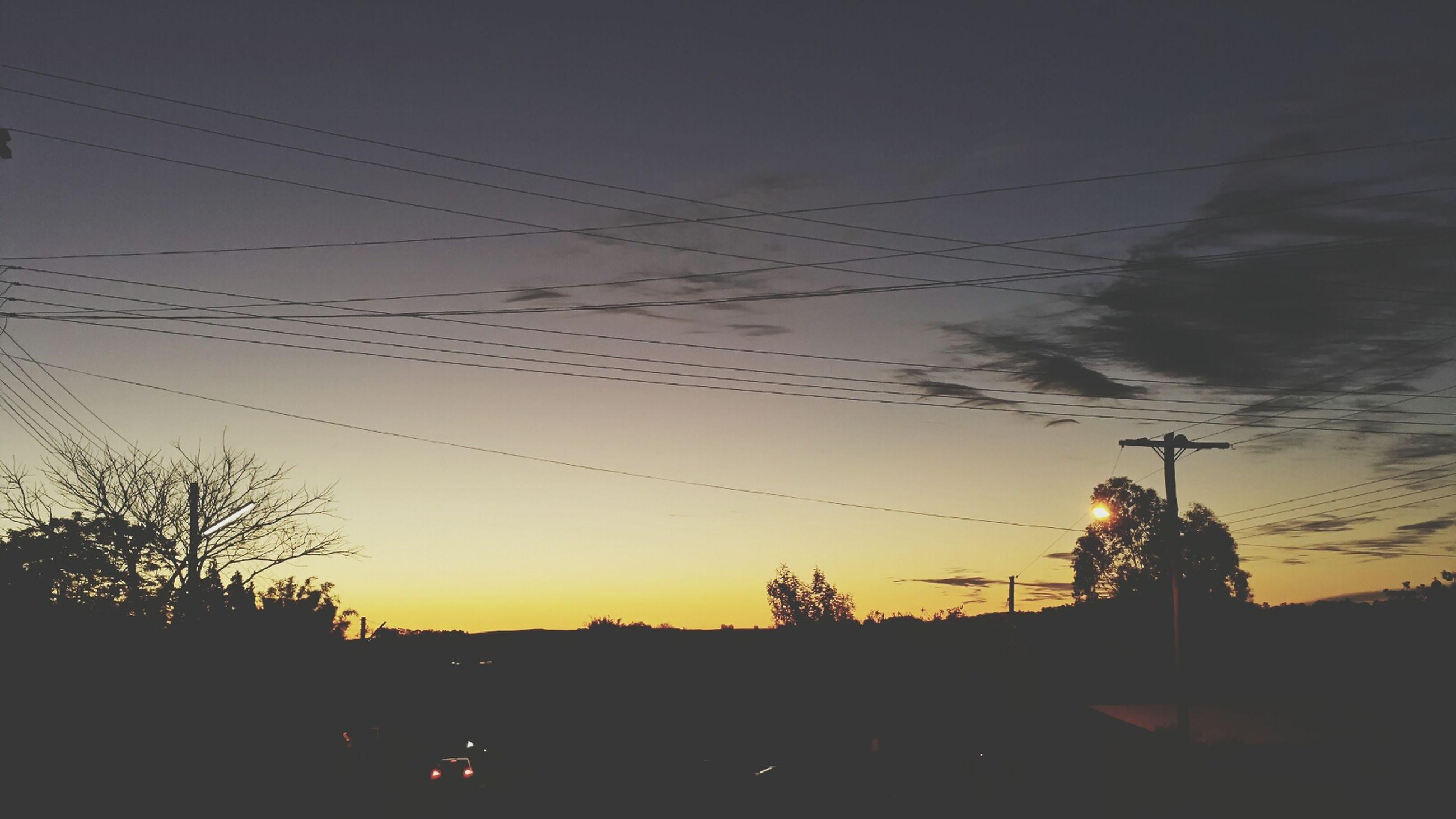 silhouette, sunset, sky, power line, tree, technology, nature, copy space, leisure activity, dusk, outdoors, lifestyles, electricity pylon, clear sky, transportation, beauty in nature, orange color, landscape
