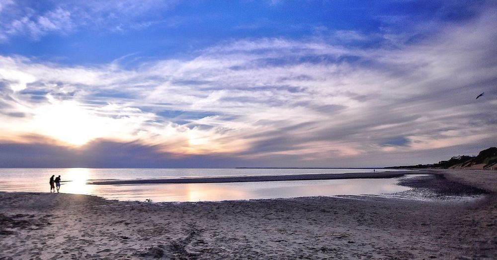 Beach Sky Sea Water Sunset Beauty In Nature Cloud - Sky Nature Scenics Tranquil Scene Horizon Over Water Bird Blue Travel Destinations Beauty Summer Happiness Love Sand Outdoors One Person Day People