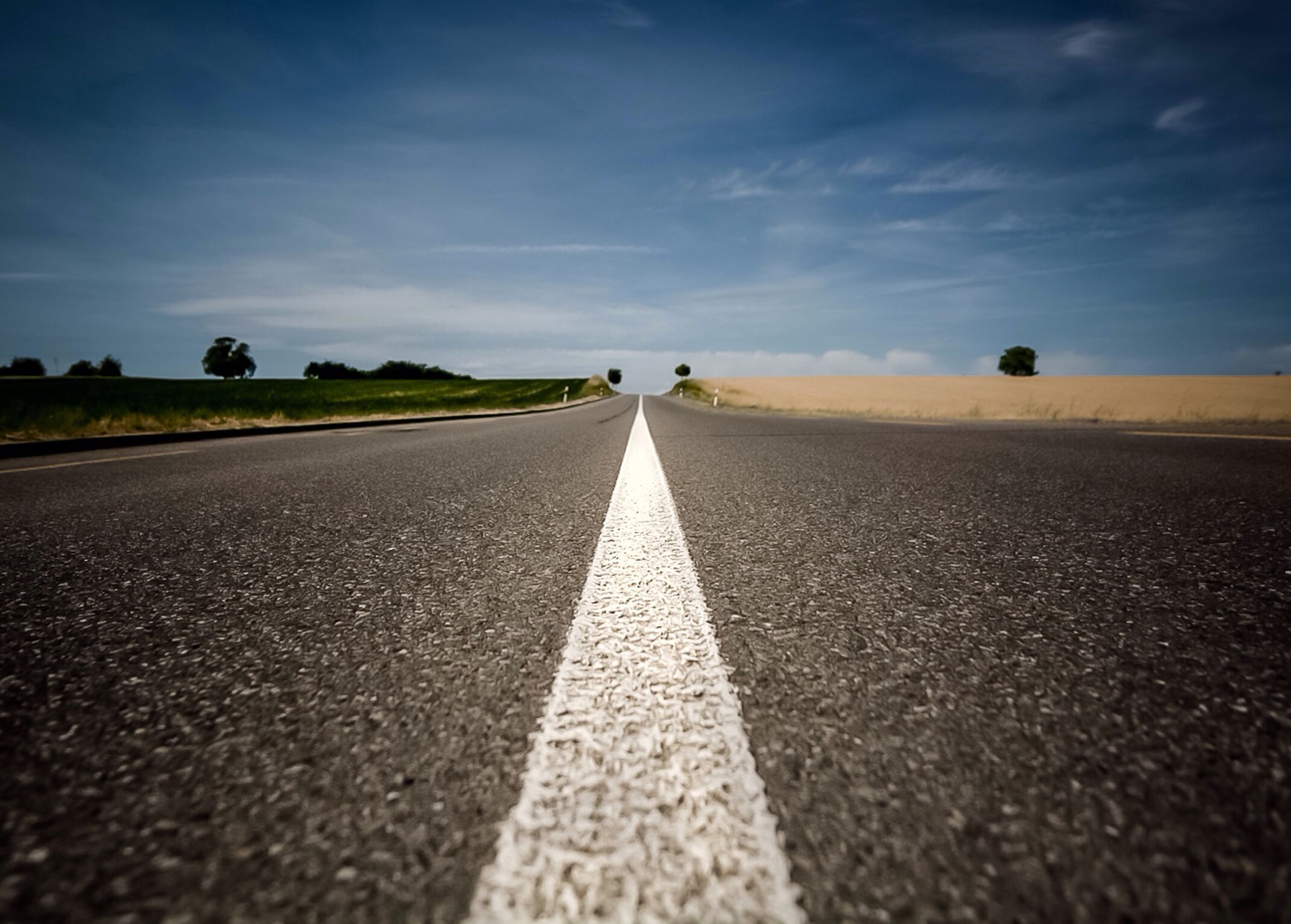 the way forward, diminishing perspective, vanishing point, surface level, transportation, road marking, road, asphalt, sky, long, empty road, cloud - sky, tranquility, empty, outdoors, cloud, street, landscape, tranquil scene, nature