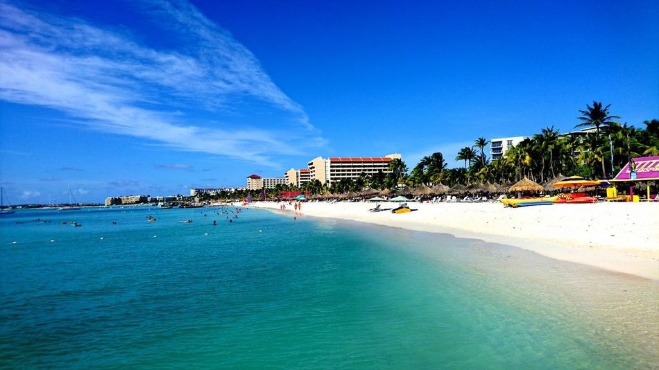 Beach Sand Sea Vacations Water Sunny Blue Travel Destinations Beauty In Nature Clear Sky Swimming