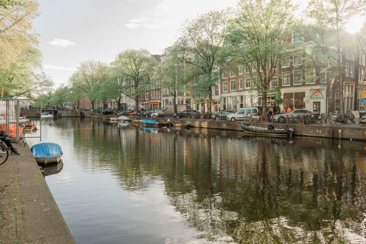 Amsterdam Canal Mode Of Transportation Transportation Water Nautical Vessel Reflection Tree Architecture Built Structure Nature Moored Plant City Waterfront Building Exterior Day Sky Car No People Outdoors Canal Canals And Waterways Amsterdam
