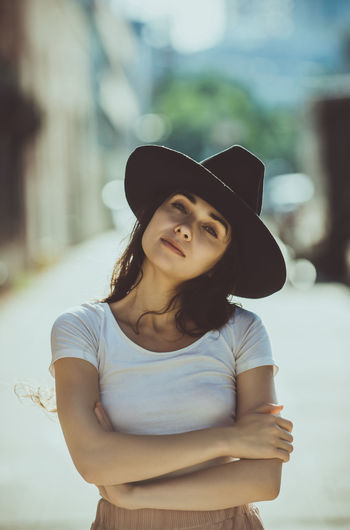 Portrait of a beautiful young woman wearing hat