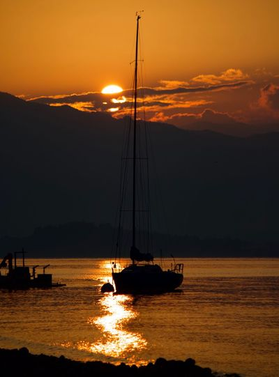 Sky Sunset Nautical Vessel Transportation Water Sailboat Mode Of Transportation Sun Tranquility Scenics - Nature Silhouette
