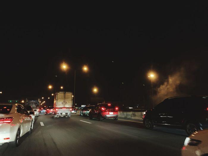 Cars on street at night