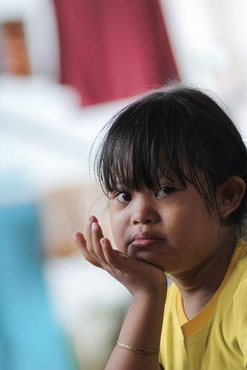 Portrait of kid feeling sad on her face