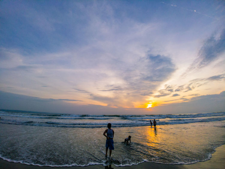 One of the most beautiful sunsets I've ever seen - Kuta beach, Bali, Indonesia. EyeEmNewHere Sea Sky Sunset Indian Ocean Ocean Beach Bali INDONESIA Travel Horizon Over Water Nature Water Outdoors Cloud - Sky Sand Silhouette People Beauty In Nature Scenics