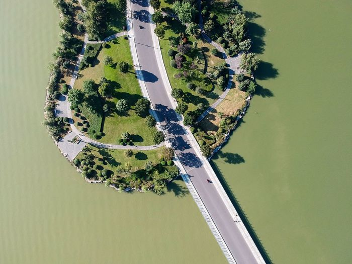 Aerial view of bridge and island over river