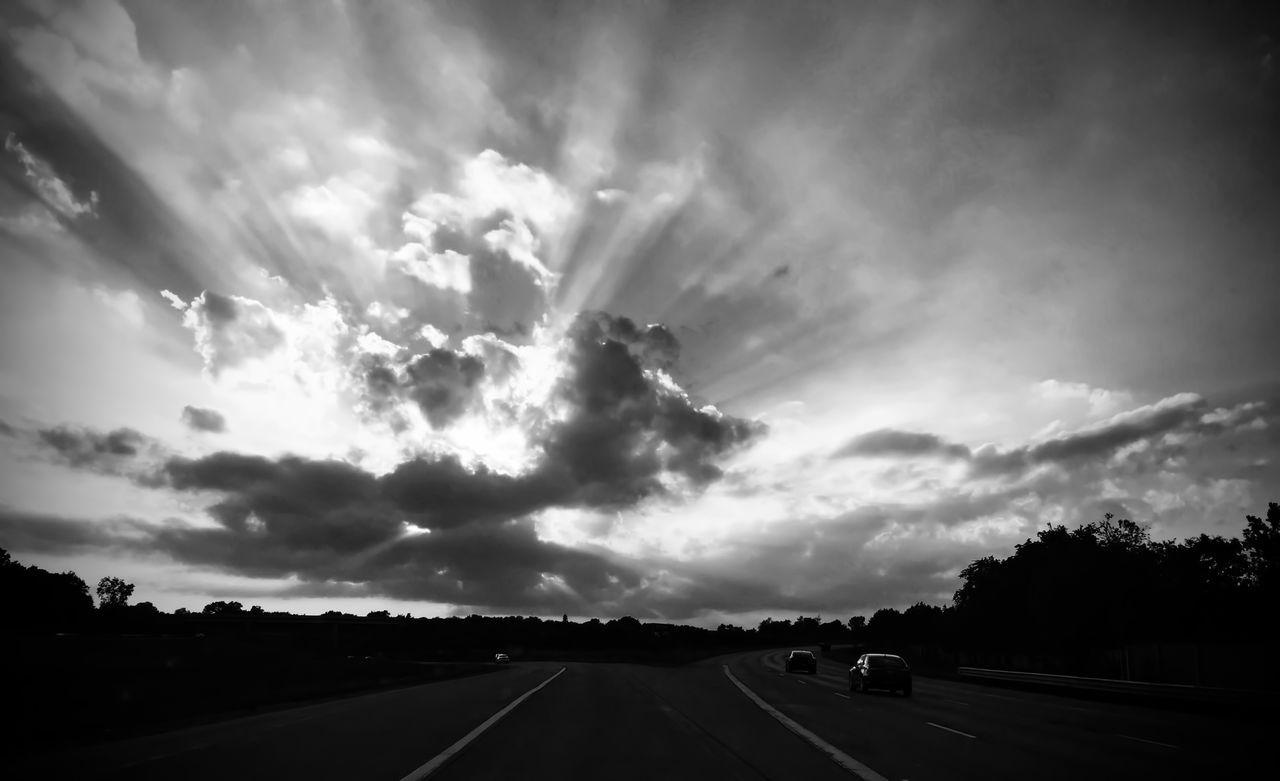 road, transportation, cloud - sky, the way forward, sky, road marking, dramatic sky, car, land vehicle, highway, scenics, storm cloud, mode of transport, street, tranquility, sunset, nature, no people, dividing line, road trip, outdoors, silhouette, tree, car point of view, day, landscape, beauty in nature, thunderstorm