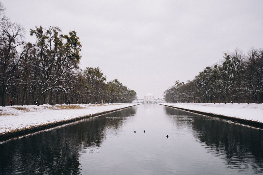 Nymphenburg Palace in winter, Munich, Bavaria, Germany. Architecture Bavaria Copy Space Horizontal Munich Nature Nymphenburg Palace Reflection Tourist Attraction  Travel Photography Tree Winter Canal Europe Germany Horizon Over Water Landmark No People Park Scenics Schloss Nymphenburg Snow Symmetry Travel Destinations Water