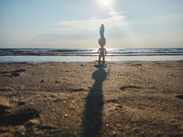 Figure on the beach shore Doll Silouette And Shadows Women Sillouette Siluet Sea Beach Full Length Standing Shadow Sand Sunlight Sunset Silhouette Shore Sandy Beach