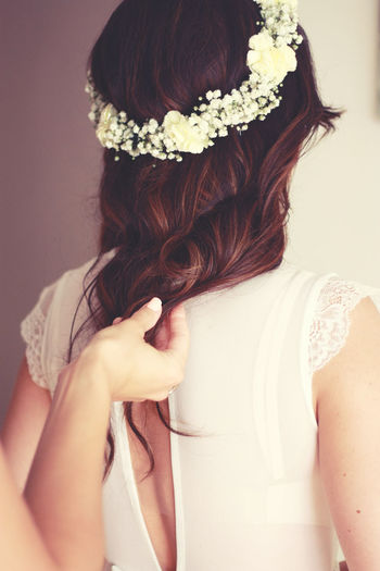 Rear view of woman with flowers in hair