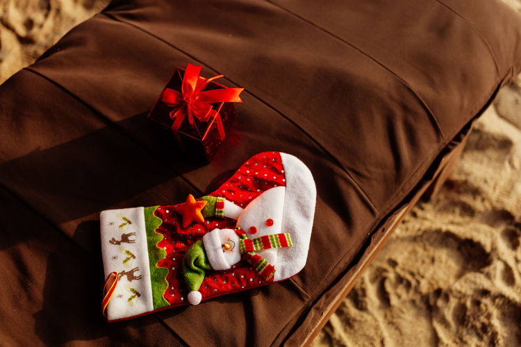 High angle view of christmas decorations on lounge chair at beach