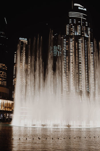 Dubai Fountain Dubai Fountain Architecture Building Exterior Built Structure City Dubai Fountain Dubai Fountains Flowing Flowing Water Fountain Illuminated Illumination Long Exposure Motion Nature Night No People Outdoors Splashing Spraying Water Waterfront