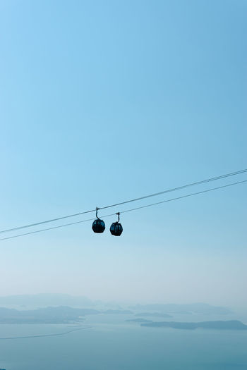 cable car Cable Car Cable Car Station Sky World Longest Higher Blue Bird Flying Flamingo Mountain Water Blue Flock Of Birds Fog Sky Animal Themes