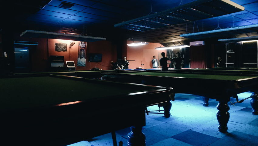Snooker time. Empty Indoors  Illuminated Built Structure Architecture Dark Retail  Large Group Of Objects Snooker_hall Snooker Table Snooker Cue Lighting People Photography People And Places.