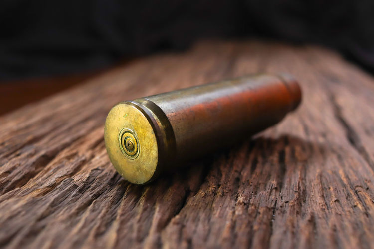 Gun Shell Wood - Material Close-up Table No People Indoors  Still Life Metal Focus On Foreground Single Object Selective Focus Work Tool Old Equipment Brown Textured  Smoking Issues Day Food And Drink Cigarette  High Angle View Leather Corkscrew Gun Bullet