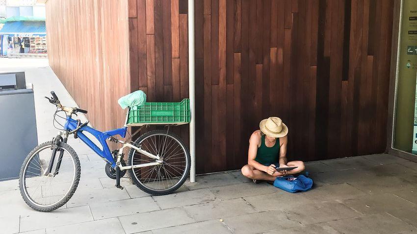 Ipad Man Hat sitting Using Crosslegged Device Mobile Screen Outdoors Internet Addiction The Secret Spaces