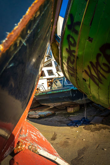 Close-up of abandoned boat moored on beach