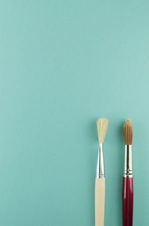 paintbrushes - art and craft Minimalist Art And Craft Art And Craft Equipment Blue Blue Background Brush Choice Close-up Colored Background Conceptual Copy Space Group Of Objects Indoors  No People Paintbrush Red Simplicity Still Life Studio Shot Three Objects Two Objects Variation