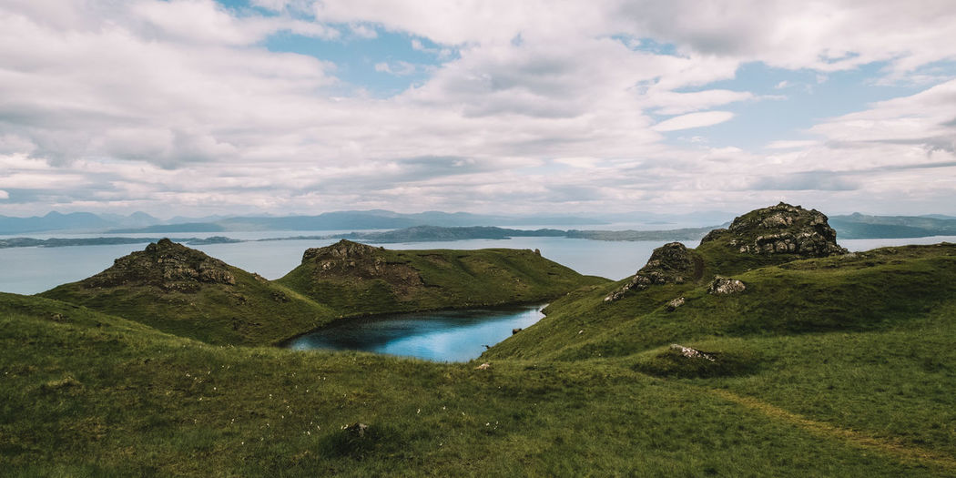Beauty In Nature Cloud - Sky Day Grass Green Color Isle Of Skye Landscape Mountain Nature No People Non-urban Scene Outdoors Scenics Scotland Sea Sky The Old Man Of Storr Tranquil Scene Tranquility Water
