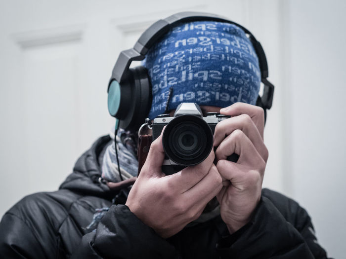 Portrait Of Man Photographing With Camera