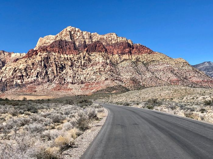 Red Rock Canyon. EyeEm Nature Lover Explore Nevada Adventure Road Trip Landscape Canyon Las Vegas Red Rock Canyon Sky Nature Road Day Sunlight Mountain Clear Sky Beauty In Nature Blue Scenics - Nature Tranquil Scene Tranquility Non-urban Scene Environment Travel Land Landscape No People Outdoors